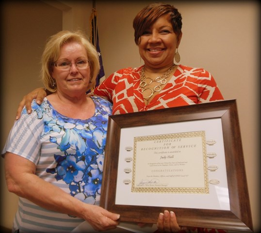 Judy Hall of Carpenters Southwest Apprenticeship Trust receives her certificate of retirement from Business Manager Jacqueline K. White-Brown, after over 36 years of service.