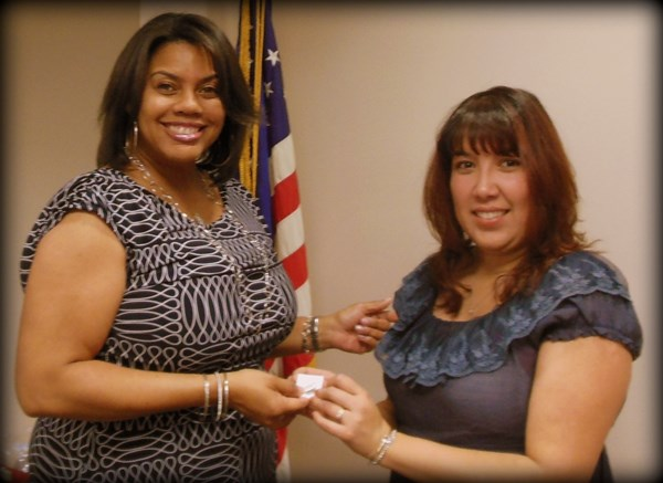 Lynnette Howard, Business Representative for OPEIU Local 537 receives her 15-year pin from President Laura Villegas.