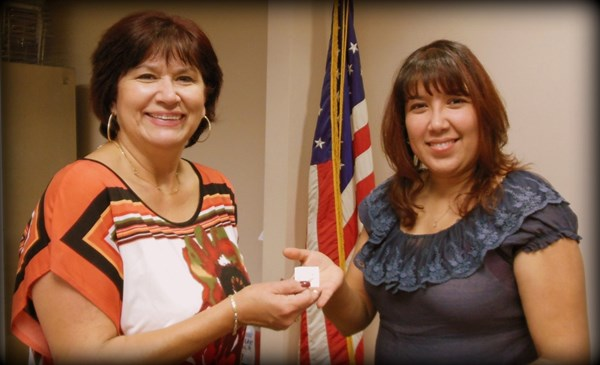 Rebecca Valero of ILWU Local 13 receives her 15-year pin from President Laura Villegas.